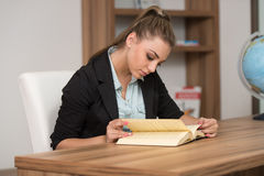 Happy Female Student In Library With Book Royalty Free Stock Images