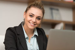 Happy Female Student In Library With Laptop Royalty Free Stock Photography