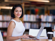 Happy female student at the library. Happy young female student sudying at the library Stock Images