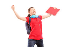 A happy female student with raised hands gesturing happiness. Isolated against white background Stock Photo