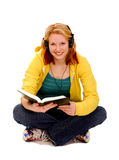 Happy Female Student Reading Royalty Free Stock Image