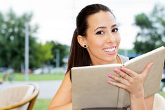 Happy female student reading Stock Photos