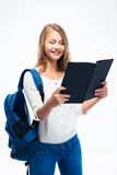 Happy female student reading book Stock Image