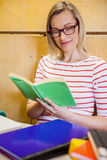 Happy female student reading a book. At the university Royalty Free Stock Images