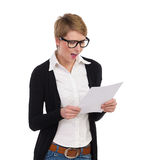 Happy female student reading documents Royalty Free Stock Image
