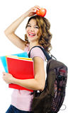 Happy female student with red apple above her head isolated on w Stock Photos