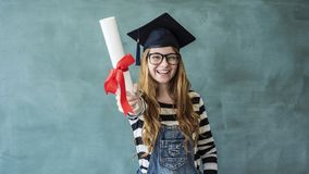 Happy female student showing diploma royalty free stock photos