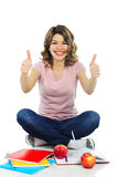 Happy female student showing thumbs up isolated on white Royalty Free Stock Images