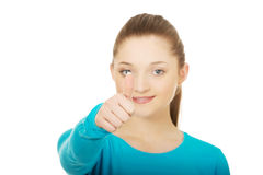 Happy female student showing thumbs up. Royalty Free Stock Photo