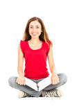 Happy female student sitting on the ground with her notebook Stock Photography