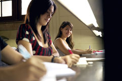 Happy female student smiling at camera in college library Royalty Free Stock Photo