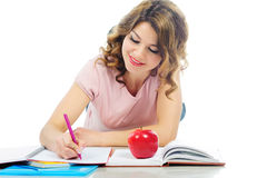 Happy female student studying on floor isolated on white Royalty Free Stock Photos