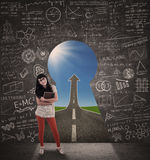 Happy female student and success road view from keyhole Stock Photos