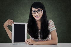 Happy female student with a tablet Stock Images