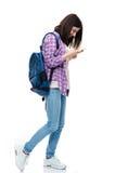 Happy female student using smartphone Royalty Free Stock Photo