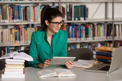 Happy Female Student Working With Laptop In Library Stock Images