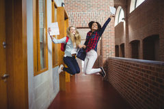 Happy female students receiving results Stock Images