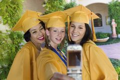 Happy Female Students Self Photographing Royalty Free Stock Photography