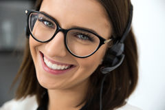 Happy female support operator in headset Royalty Free Stock Photography