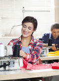 Happy Female Tailor Working In Sewing Factory Royalty Free Stock Images