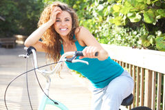 Happy Female Taking A Break On Boardwalk With Bicycle Royalty Free Stock Photos