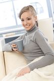 Happy female with tea and blanket Royalty Free Stock Photography
