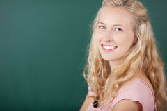 Happy Female Teacher Against Chalkboard Royalty Free Stock Photos