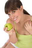 Happy female teenager with healthy apple Royalty Free Stock Photo