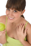 Happy female teenager with healthy apple Stock Photo