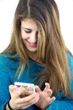Happy female teenager playing with cell phone texting Stock Photography