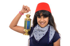 Happy Female Teenager with Red Fez Holding Ramadan Lantern. On White Background Royalty Free Stock Images