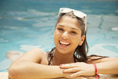 Happy female teenager in swimming pool Stock Image