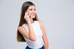 Happy female teenager talking on the phone Stock Images