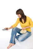 Happy female teenager watching television Stock Photos