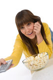 Happy female teenager watching television Royalty Free Stock Photo