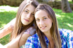 Happy female teenagers laughing having fun in park in summer Royalty Free Stock Photo