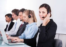 Happy female telephone worker Royalty Free Stock Photo