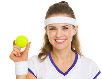 Happy female tennis player showing tennis ball Stock Images
