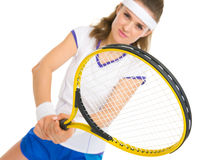 Happy female tennis player in stance Stock Images