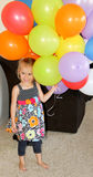 Happy female toddler with balloons Stock Images