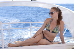 Happy female tourist on sailboat. Beautiful woman relaxing on a yacht Stock Photography