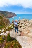 Happy female tourist standing on Cape Roca, Sintra, Portugal Stock Photo