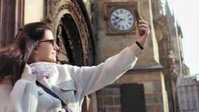Happy female tourist woman taking selfie using smartphone posing at historic palace background. Happy female tourist woman enjoying taking selfie using stock footage