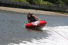 Happy Female tubing. A female tubing in the water royalty free stock photos
