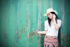 Happy female using smart phone Stock Image
