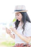Happy female using smart phone Stock Photos