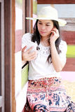 Happy female using smart phone Royalty Free Stock Photography