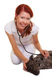 Happy female vet examing sick dog Royalty Free Stock Photo