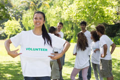 Happy female volunteer holding tshirt Royalty Free Stock Photography