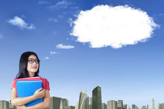 Happy female worker and cloud Stock Photo